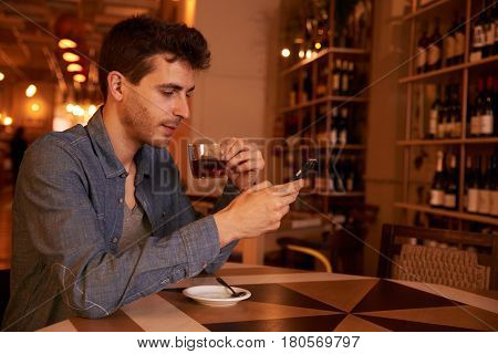 Charming Millenial With Tea In Restaurant