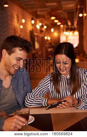 Joyously Happy Millenial Couple In Restaurant