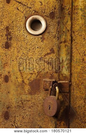 Old, Rusty Lock On A Metal Door. Close The Barn From Robbery And Theft