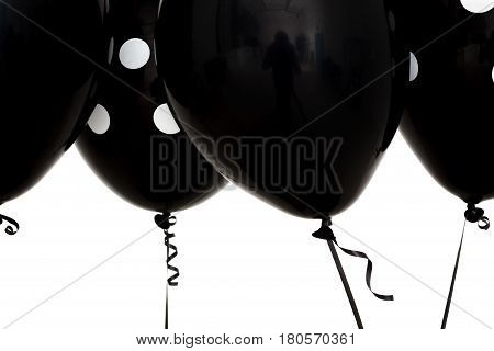 Black Inflatable Balls For A Sad Holiday. Depression And Sadness Instead Of Joy.