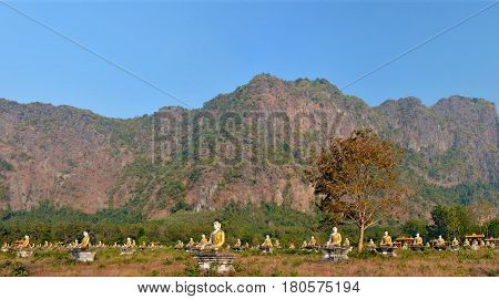 Panoramic View Of The Garden Of One Thousand Buddhas In Hpa-an, Myanmar. Mount Zwegabbin In The Rays
