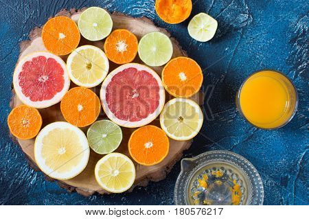 Fruits Rich In Vitamin C On The Dark Blue Table