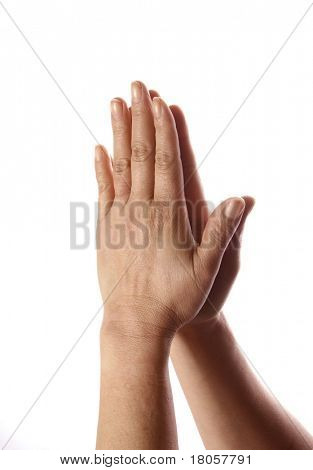 Two hands clasp against each other as a sign of thankfulness, tratitude and appreciation.