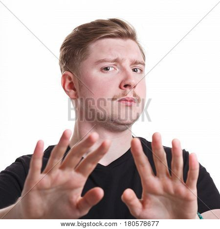 No. Negative human emotion. Man expressing denying on white studio background, cutout