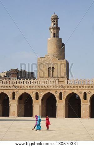 CAIRO, EGYPT - JANUARY 23, 2016: The children plays in the courtyard of Ibn Tulun Mosque. The Mosque is one of the oldest Islamic buildings in Cairo, Egypt