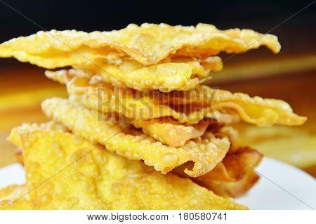 deep fried crispy dumpling strips on dish