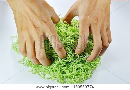 hand thresh raw Chinese jade noodle prepare to cook