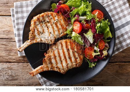 Barbecue Spicy Pork Chop With Fresh Vegetable Salad Close-up. Horizontal Top View
