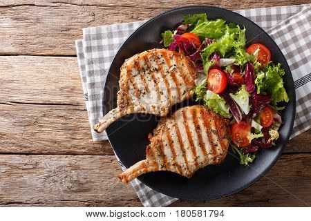 Bbq Spicy Pork Cutlet With Mixed Salad On A Plate Close-up. Horizontal Top View