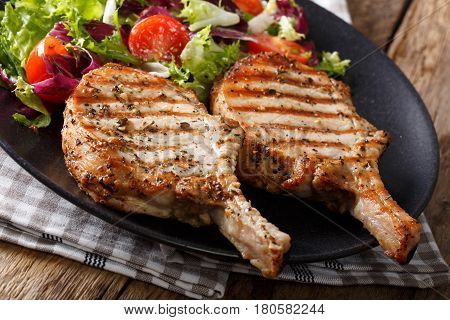 Barbecue Spicy Pork Chop With Fresh Vegetable Salad Close-up. Horizontal