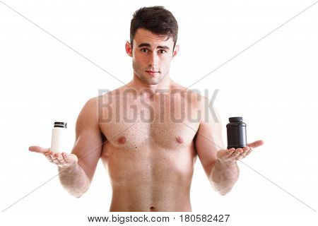 Sexy Male Body Builder Holding A Boxes With Supplements On His Biceps