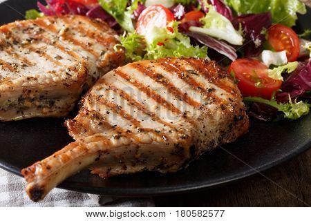 Barbecue Spicy Pork Steak With Fresh Vegetable Salad Macro. Horizontal