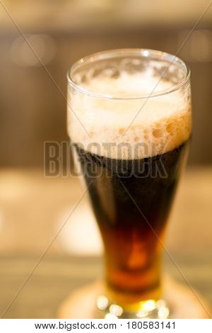 Glass - pint- of dark beer with foam
