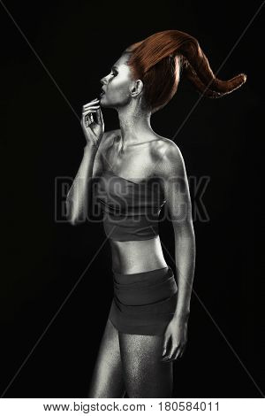 Beautiful young woman with amazing body-art as capricorn on dark background. Zodiac signs concept