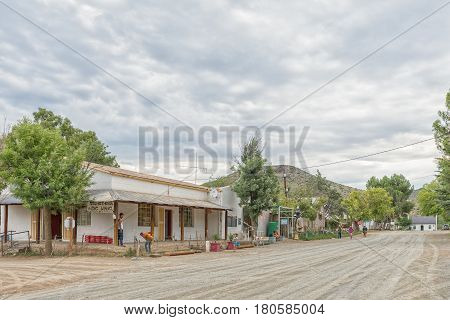 NIEU BETHESDA SOUTH AFRICA - MARCH 21 2017: A street scene with a with a shop and several unidentified people in Nieu-Bethesda an historic village in the Eastern Cape Province