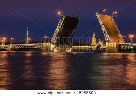 Beautiful view of the breeding of bridges in the night St. Petersburg from the embankment of the Neva River