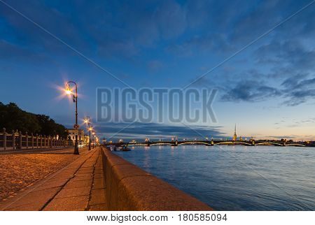 Beautiful view of the night St. Petersburg from the embankment of the Neva River