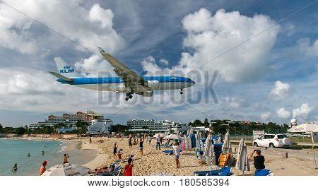Saint Martin Dutch Antilles March 21 2017: KLM passenger jet is about to land at the Princess Juliana airport.