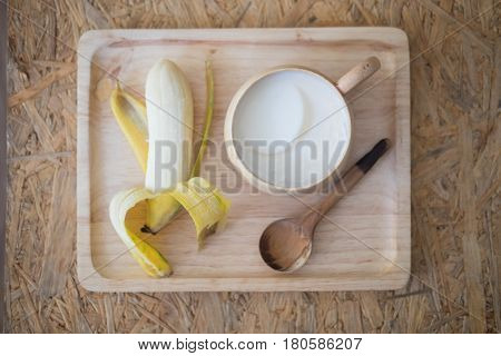 Healthy food set on wood tray soy milk dessert made of tofu with fresh banana on wood tray