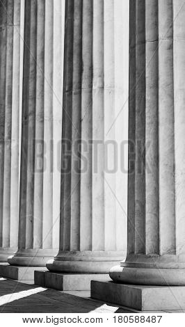 black and white photo of 'carlo felice' theater's columns in genoa italy