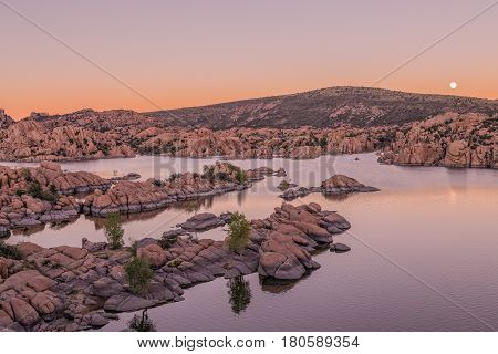 a full moon rising over scenic Watson lake Prescott Arizona