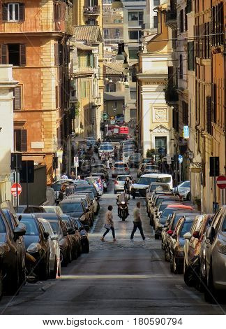 ROME ITALY - MARCH 26 2017: People walking in via Manara street in rione Trastevere