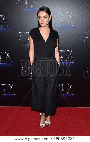 LOS ANGELES - MAR 28:  Mila Kunis arrives for the CinemaCon 2017-STX Films