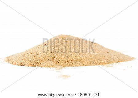 Pile of yellow sand isolated on white background selective focus at front