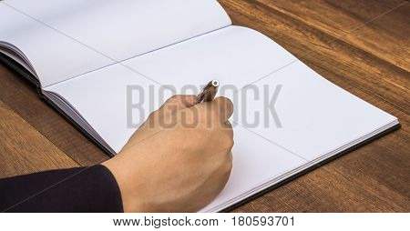Businessmen are signed with a pen.Business Concept