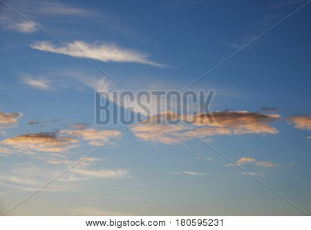 Cumulus and cirrus clouds sundown. Clouds of red pink and orange. Background