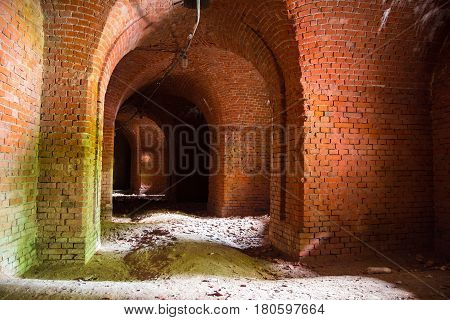 Arched corridors of the old fortification structure of red brick, Kaliningrad, Russia
