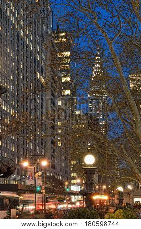 NYC streets at night. Midtown Manhattan - 42nd Street with Chrysler Building view from the Bryant Park.