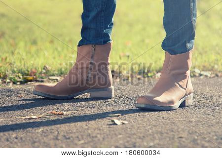 Woman in jeans and boots. Sunny day