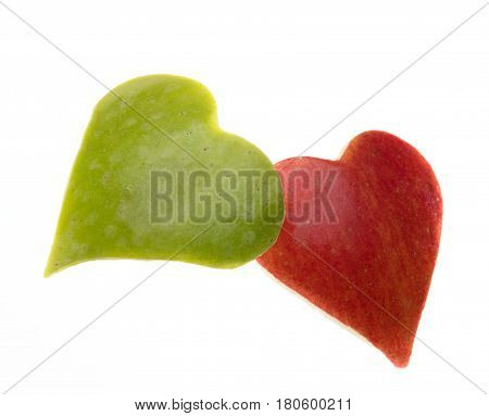 two hearts one green another one red made of apples conceptual photo about health lifestyle white background