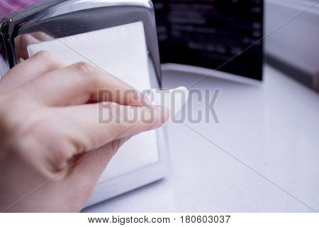 Napkin coming out of a napkin maker