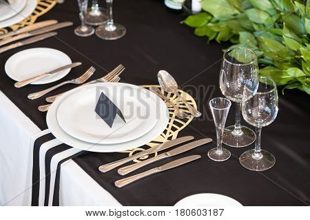 Wedding decor. Wedding interior, Festive black decor, table layout concept. expectation of guests.