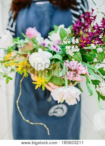 Beautiful floral composition and woman florist. Wedding floristic.