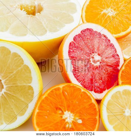 Colorful background made of lemon, orange, grapefruit, sweetie and pomelo. Flat lay, top view. Food pattern