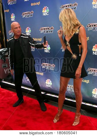 NEW YORK-AUG 11: Comedian Howie Mandel (L) and model Heidi Klum attend the 'America's Got Talent' season 10 taping at Radio City Music Hall on August 11, 2015 in New York City.