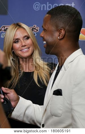 NEW YORK-AUG 12: Model Heidi Klum (L) and TV personality AJ Calloway attend the 'America's Got Talent' Season 10 Results Show at Radio City Music Hall on August 12, 2015 in New York City.