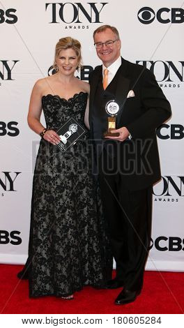 NEW YORK-JUN 7: Laura Kepley (L) and Kevin Moore hold the Regional Theatre Tony Award at the American Theatre Wing's 69th Tony Awards at Radio City Music Hall on June 7, 2015 in New York City.