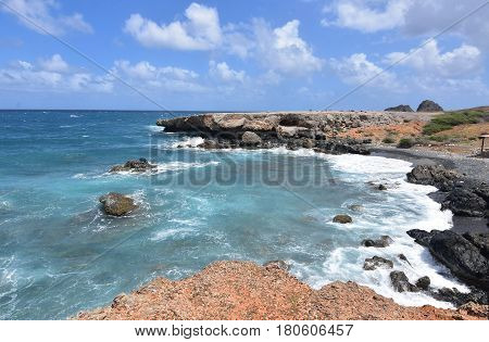 Pretty black sandstone beach on the Island of Aruba.