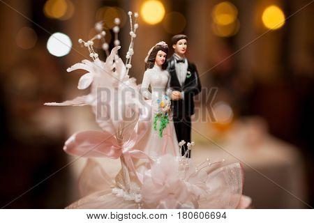Figurines on top of wedding cake, wedding decoration on the cake