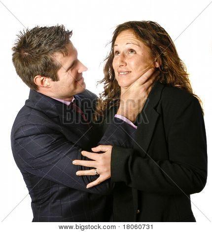 Businessman strangling a businesswoman.