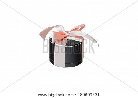 portable mobile speaker, tied with pink ribbon isolated on white background