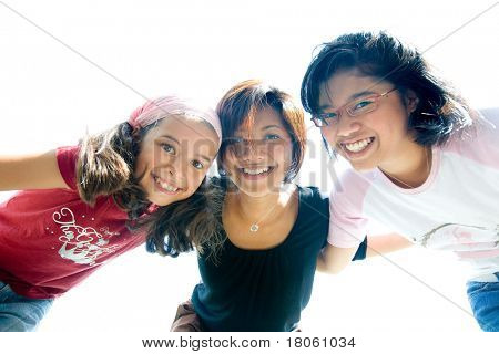 Young girls from a family having fun playing together
