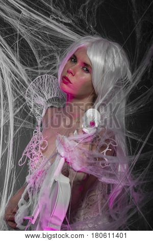 Retro, Violinist with white violin, beautiful girl with silver hair and lace clothes