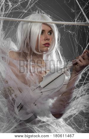 String, Violinist with white violin, beautiful girl with silver hair and lace clothes