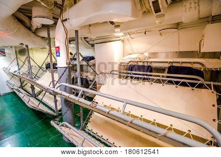 HONOLULU, OAHU, HAWAII, USA - AUGUST 21, 2016: camp beds in sleeping room of USS Bowfin Submarine SS-287 at Pearl Harbor. Historic Landmark of the Japanese attack in WW II.