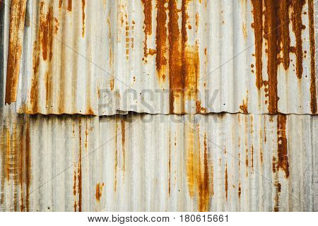 A rusty corrugated iron metal fence Old Zinc wall